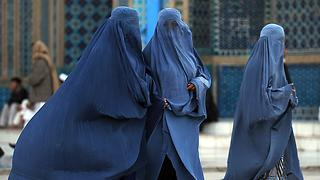 Burqa-clad women walk at the Hazrat Ali Shrine in the northern town of Mazar-i-Sharif in Balkh province on March 19, 2009. Tens of thousands of Afghans from all over the war-scarred country have poured into the northern town ahead of the Afghan New Year, called Naw Ruz which is due on March 21. Afghans come to Mazar-i-Sharif because of the presence of the Hazrat Ali shrine where special religious ceremonies are taking place on New Year's day. AFP PHOTO/SHAH Marai (Photo credit should read SHAH MARAI/AFP/Getty Images)